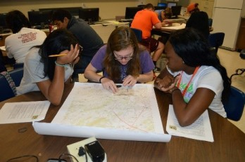 Miracle Walls (the author), Rachel Strickland, and Sydelle Young practicing map skills